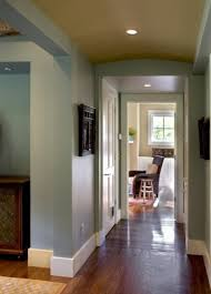 beautiful tall baseboards and bright paint color in hallway