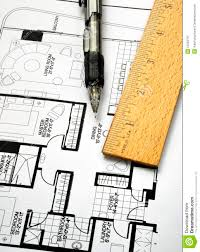 drawing the floorplan with a pen and ruler royalty free stock