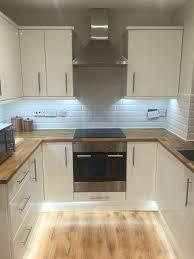b q kitchen wall cabinets white b q small kitchen white gloss wooden subway tiles