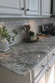 floor and decor granite countertops brown granite with small white subway tiles and warm gray