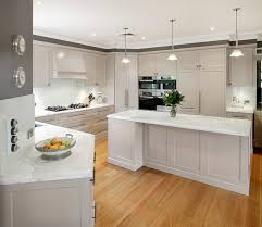 kitchen white cabinets with granite cream backsplash grey