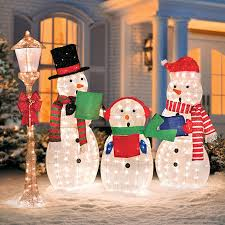 caroling snowmen family lighted outdoor decorations