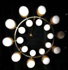 globe chandelier with white glass balls on brass frame