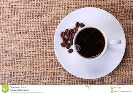 сup of coffee over burlap background top of view royalty free