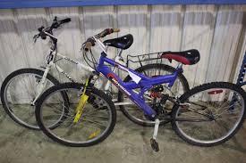 jeep cherokee mountain bike 2 bikes blue supercycle full suspension mountain bike u0026 white
