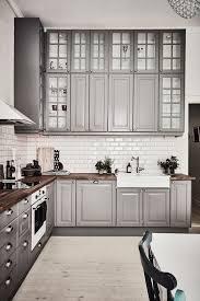 granite countertops light grey kitchen cabinets lighting flooring