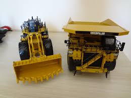 cat 99f wheel loader cat 793d mining truck pá carregadei u2026 flickr