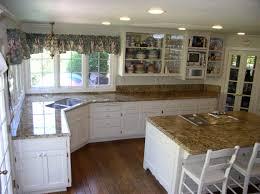 running bone shape pattern backsplashes white kitchen cabinets