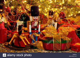 nutcrackers hobby horse and gifts under victorian christmas tree
