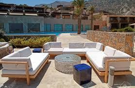 outdoor furniture on beautiful mediterranean patio in summer stock