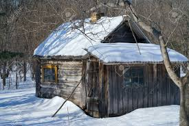 the very small cabin in winter forest stock photo picture and