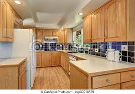 white kitchen countertops with brown cabinets kitchen room interior with cabinets and tile back splash trim