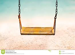 Beach Color vintage color tone style of yellow swing on sand sea beach summer