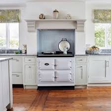 these hand made classic country kitchen cabinets and mantle frame