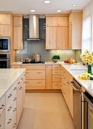 light brown wooden maple kitchen cabinets with storage and drawers