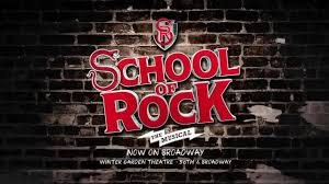 it begins on a dark stage then a beam of rock the musical