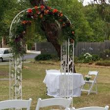 Wedding Arches Melbourne Metal Wedding Arch With Orange And Purple Flowers The Wedding
