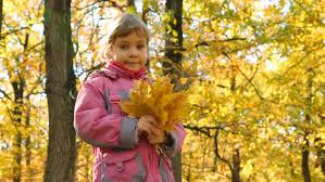 hildren and in the park plays with children in autumn