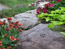 Garden Rock Wall by Building A Rustic Rock Wall For Water Retention And Control