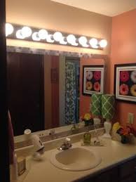 stick on bathroom mirrors mirror makeover w peel and stick tiles bathroom pinterest