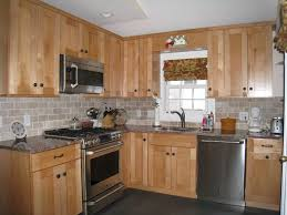granite countertop renovate kitchen cabinets railroad tile