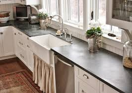 white kitchen cabinets with soapstone countertops and backsplash
