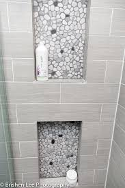 Grey Tile Bathroom by Two Shower Nooks With Marble Pebbles And Horizontal Grey Porcelain