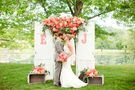 wedding backdrop green vibrant coral orange and pink wedding mon cheri bridals