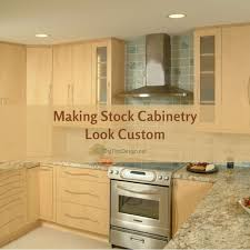 how to make cheap kitchen cabinets look better tips to stock cabinetry look custom while staying in