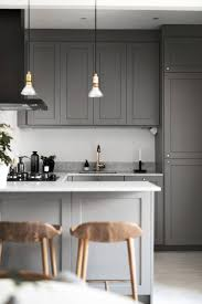 Gray Cabinets Kitchen Dark Grey Kitchen With Marble Worktop And Brass Details Blog