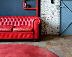 Round Red Rugs Red Chesterfield Sofa With Brick Flooring And Round Red Rug