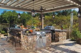 Tropical Outdoor Kitchen Designs Outdoor Kitchen Pergola Also Columns Among Green Landscaping View
