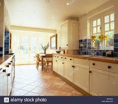 terracotta tiled floor in open plan kitchen dining room extension