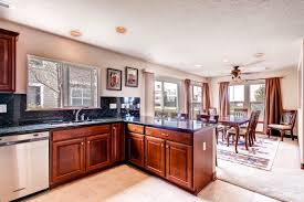 small kitchen open concept lakeshore condo living room design by