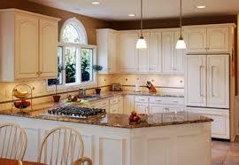 Granite Countertops With White Kitchen Cabinets by White Kitchen Cabinets With Beautiful Crem Granite Countertops