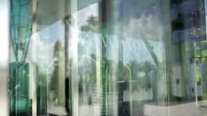 entrance glass door people enter through the automatic glass door on presentation
