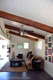 vaulted ceilings with exposed beams faux wood workshop