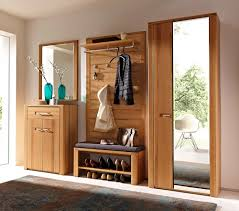 a classy narrow wood entryway storage bench along with clothes