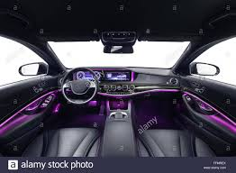 car interior luxury black seats with violet ambient light stock