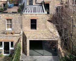 bureau de change 15 e selgascano extends second home s building with rooftop space