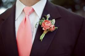 coral boutonniere coral boutonniere but with a gray suit wedding ideas