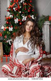 beautiful young pregnant woman christmas home stock photo