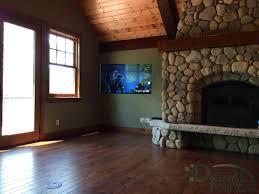 digital horizons television installation besides deep fireplace