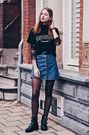 short biker boots fashion blogger from amsterdam wearing a denim skirt with