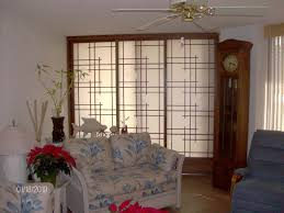 white frosted glass sliding room divider with brown wooden frames