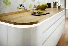 curved end cupboards and sleek doors with integral handles gives