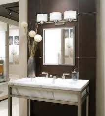 bathroom white tub beside bathroom mirrors with lights industrial