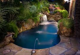 Pools For Small Spaces by Another Small Pool With Beachfront Entry And A Lighted Waterfall