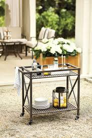 suzanne kasler s summer 2014 collection how to decorate suzanne kasler s outdoor furniture collection for ballard designs outdoor bar cart designed by suzanne kasler