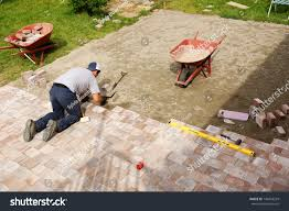 young man installing paver bricks large stock photo 142053229